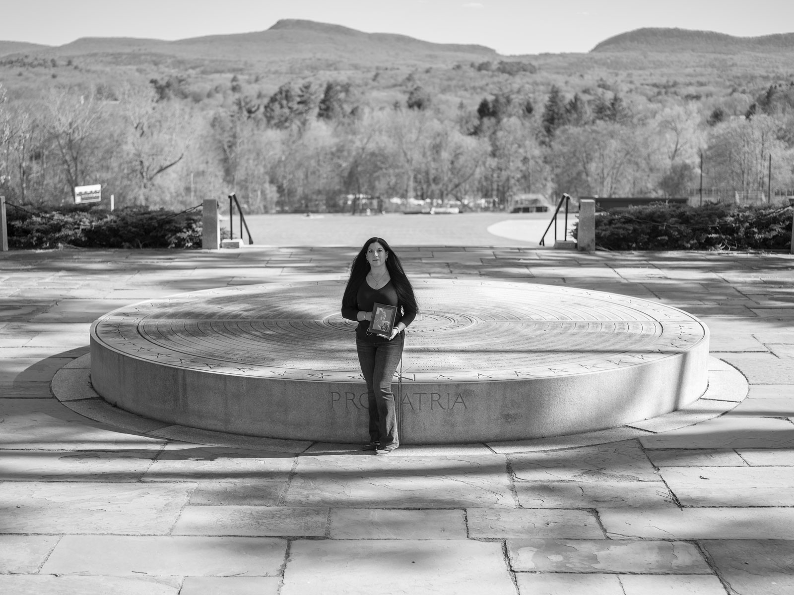 Carolyn Margolin stands in front of the War Memorial