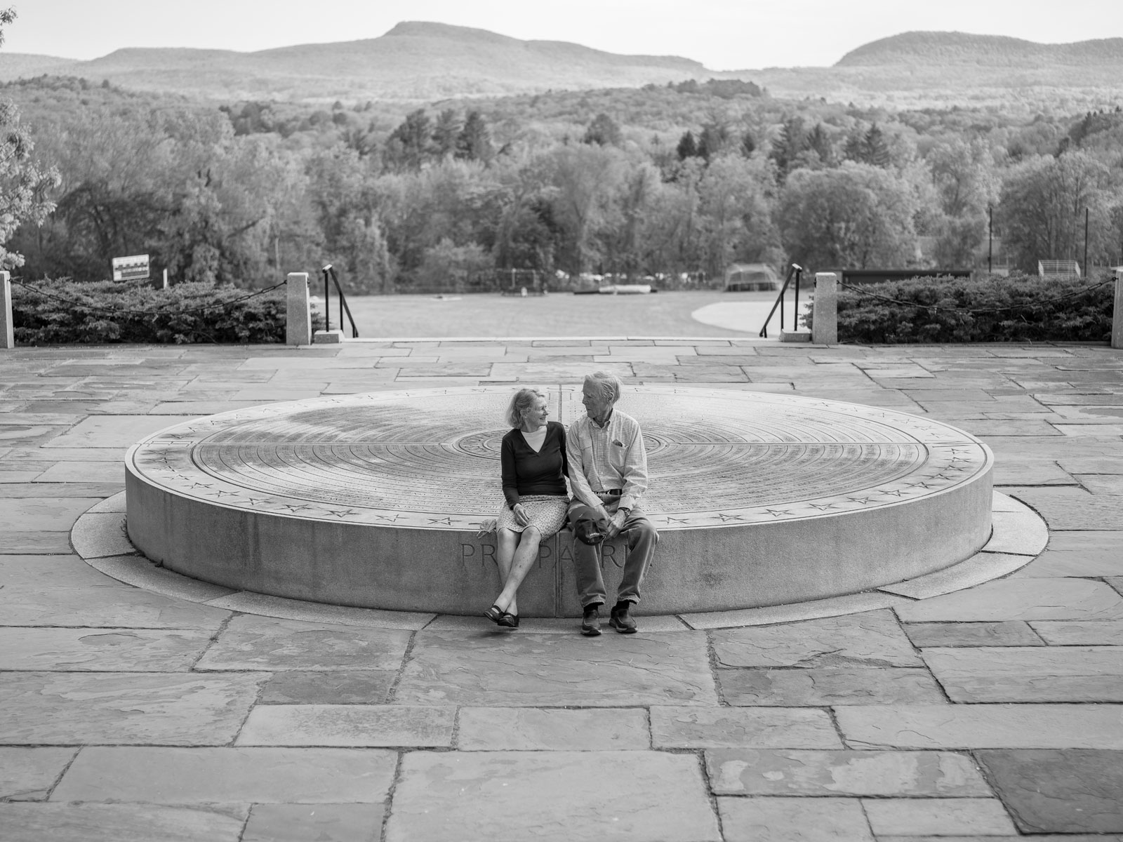 Chuck and Polly Longsworth sit on the War Memorial