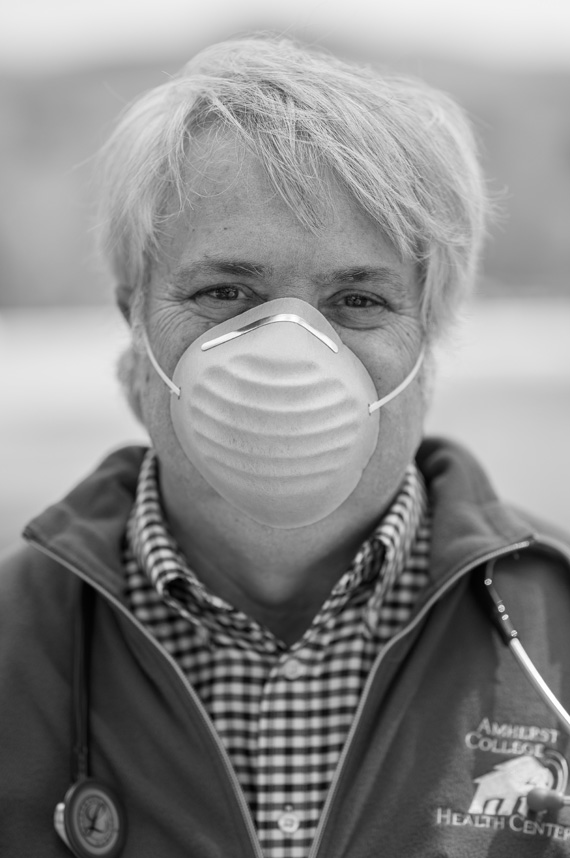 Edward McGlynn wears a surgical mask and a stethoscope