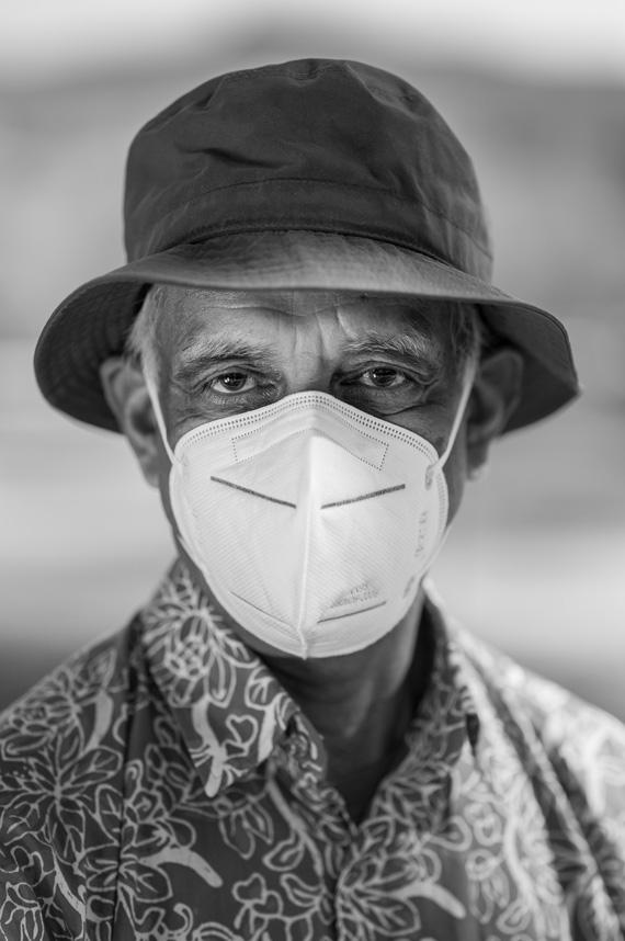 Jagu Jagannathan wears a hat and a mask