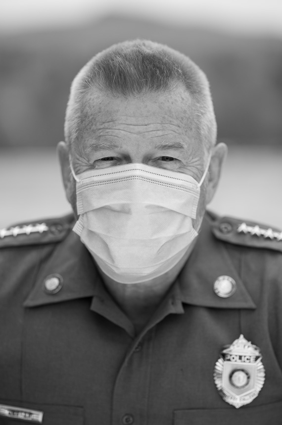 Police chief John Carter wears his uniform and a mask