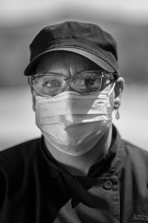 Maria Ortiz wears an Amherst dining services uniform and a mask