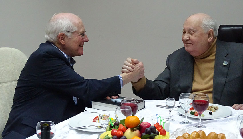 William Taubman and Mikhail Gorbachev shaking hands