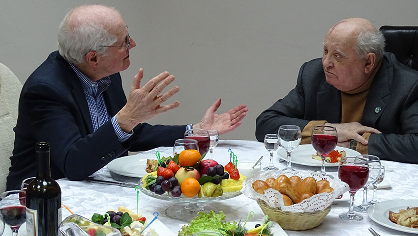 William Taubman and Mikhail Gorbachev conversing over dinner