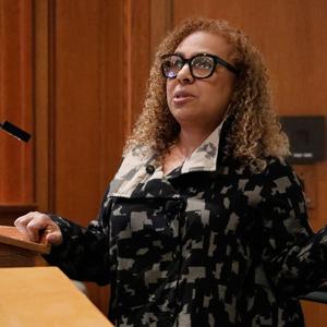 Kellie Elisabeth Jones 81 speaking at podium