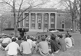A black and white photo of a group of students outside Converse Hall