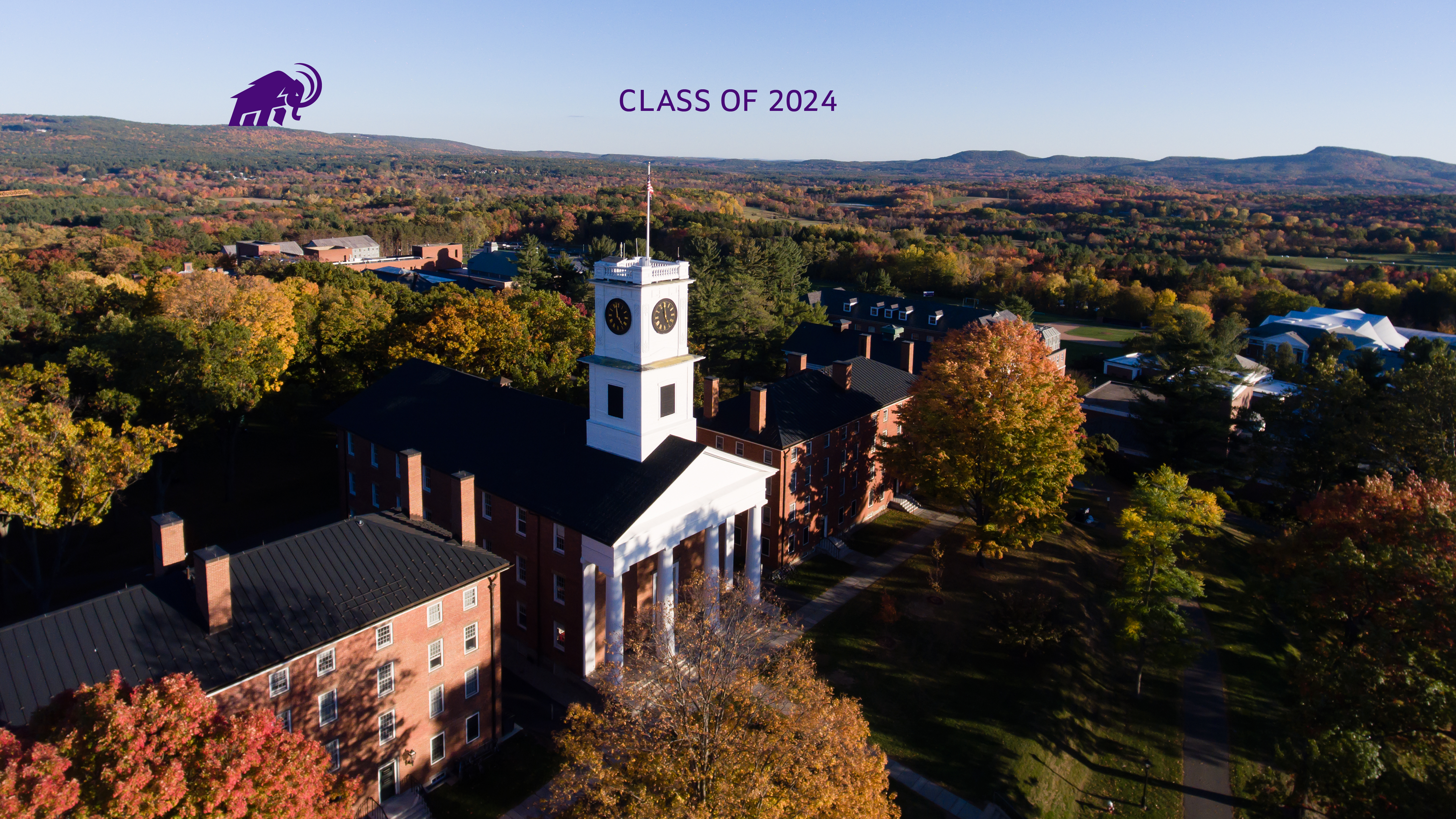 Class of 2024 on an aerial photo of campus showing Johnson Chapel and a mammoth walking on the range