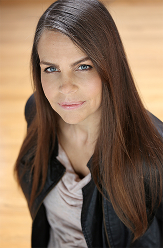 A portrait of Margaret Stohl looking up into the camera