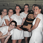 A group of women tennis players holding a trophy