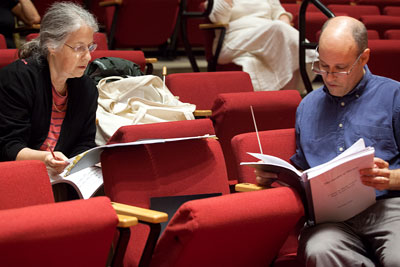 Chernin and Sawyer sit in Buckley seats, reviewing notes