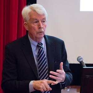 Philip Landrigan speaking at a microphone
