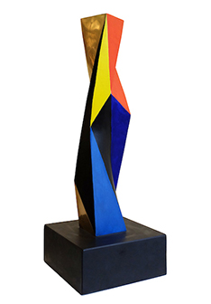 A modern sculpture of a many-sided multi-colored column