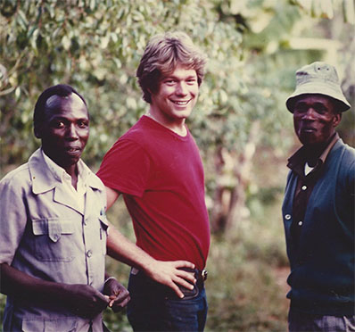 Rand Cooper poses with two unidentified men in Kenya