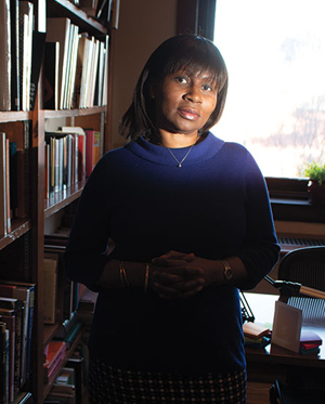 Rosemary Effiom in her office lined with books