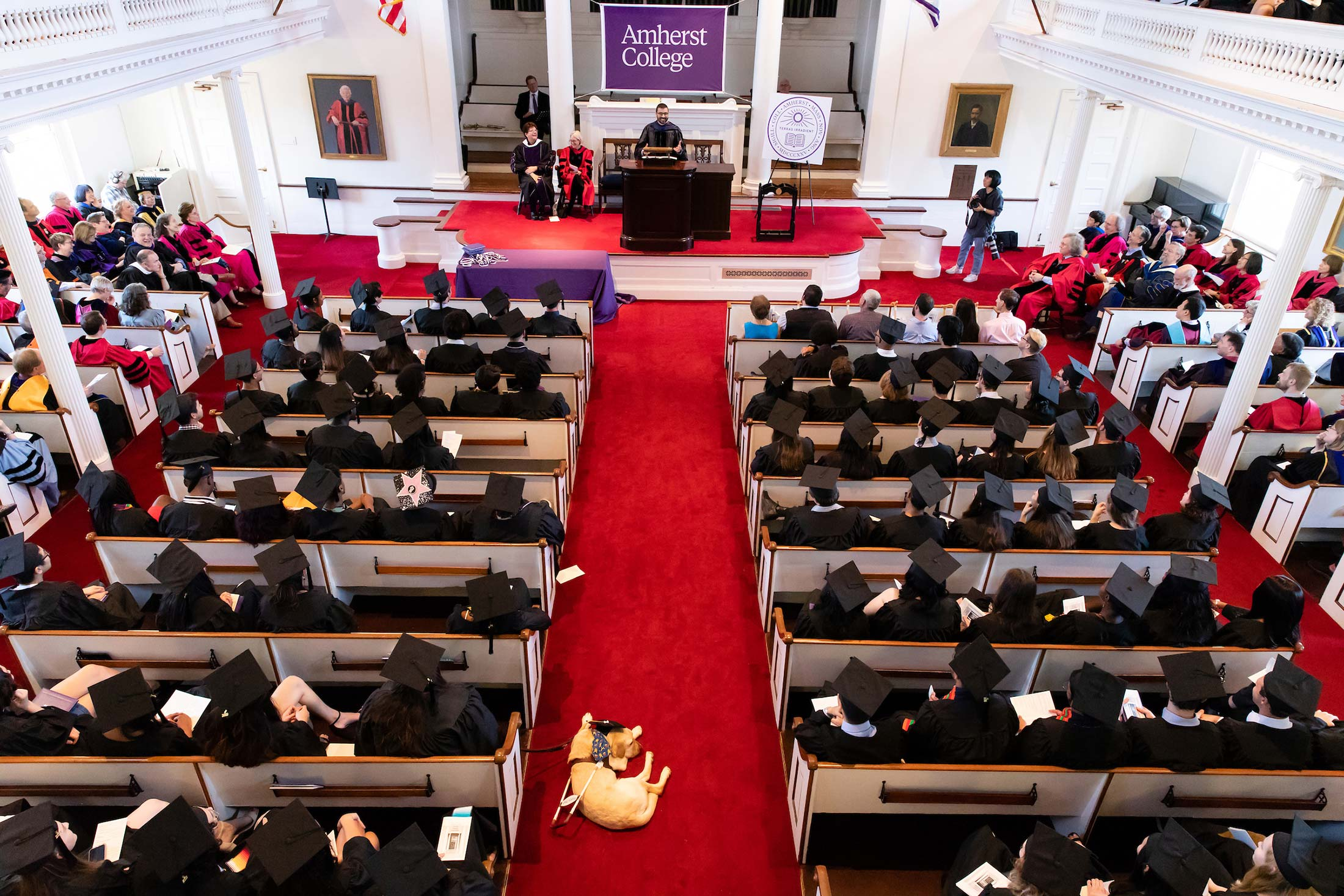 Student in commencement regalia gather in Johnson Chapel at Amherst College
