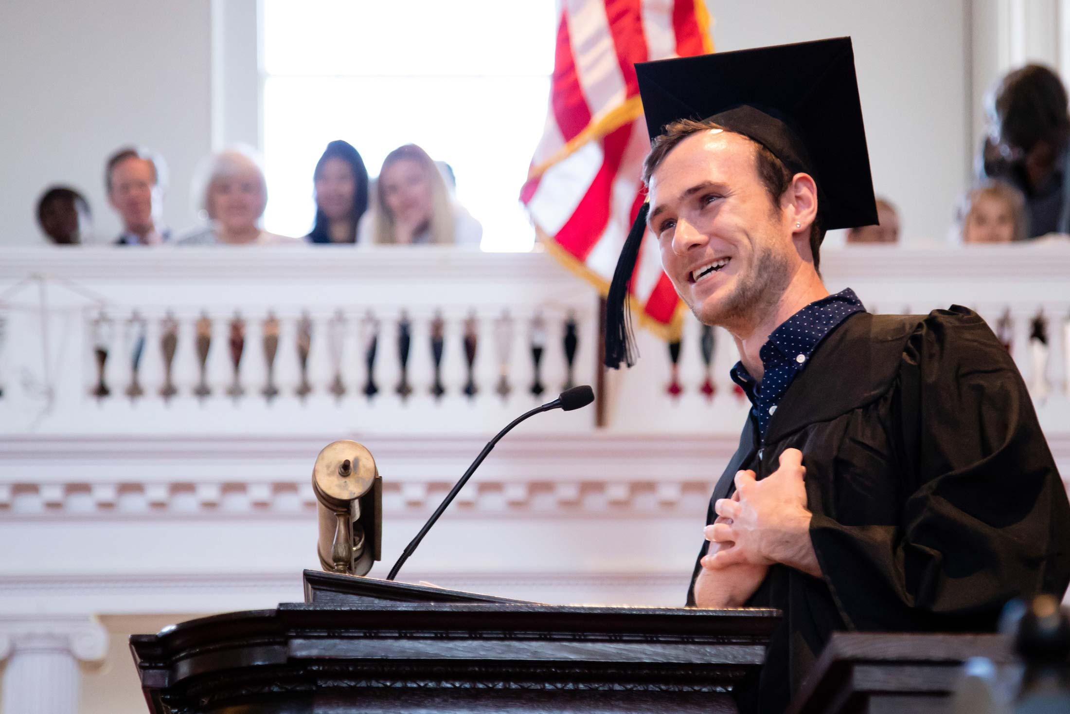 Tucker Meijer '19 speaking to his classmates during Senior Awards Assembly in Johnson Chapel at Amhert College
