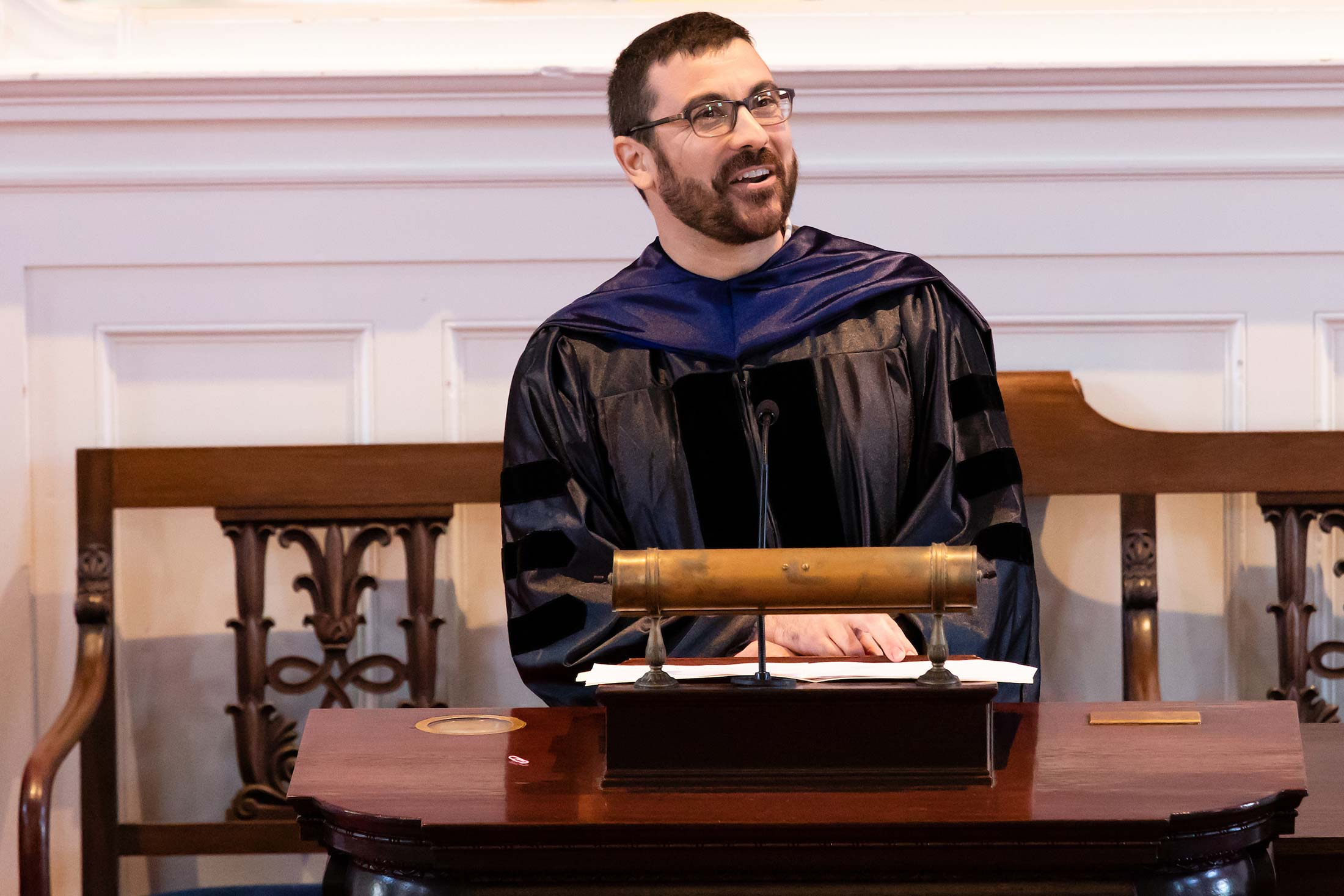 Professor Josef Trapani speaking to students during Senior Awards Assembly in Johnson Chapel at Amherst College