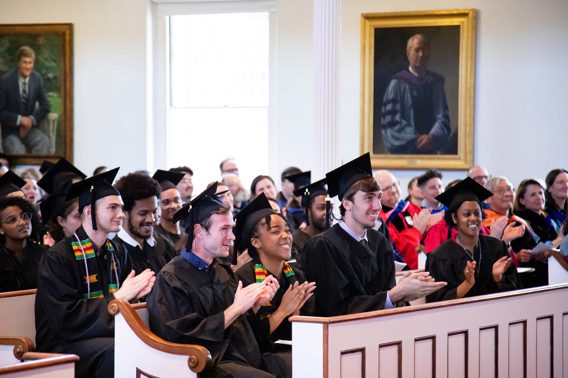 Students listening to speeches during Senior Awards Assembly in Johnson Chapel at Amherst College