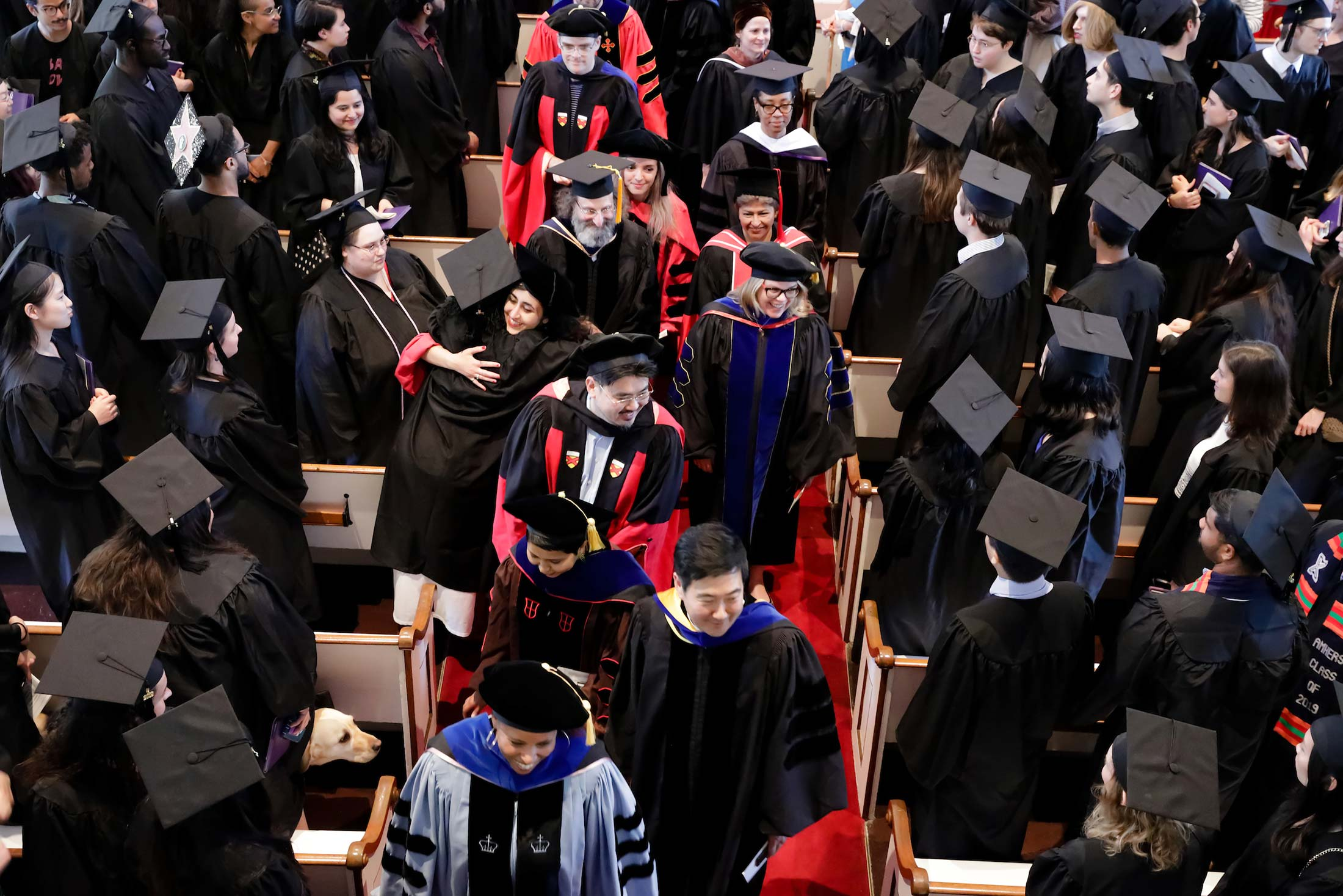 Professors exiting Johnson Chapel after Senior Awards Assebmly