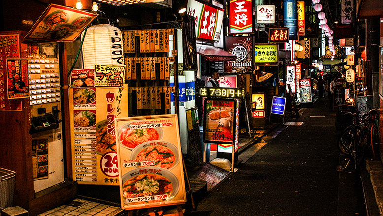 A brightly neon-lit street in Tokyo