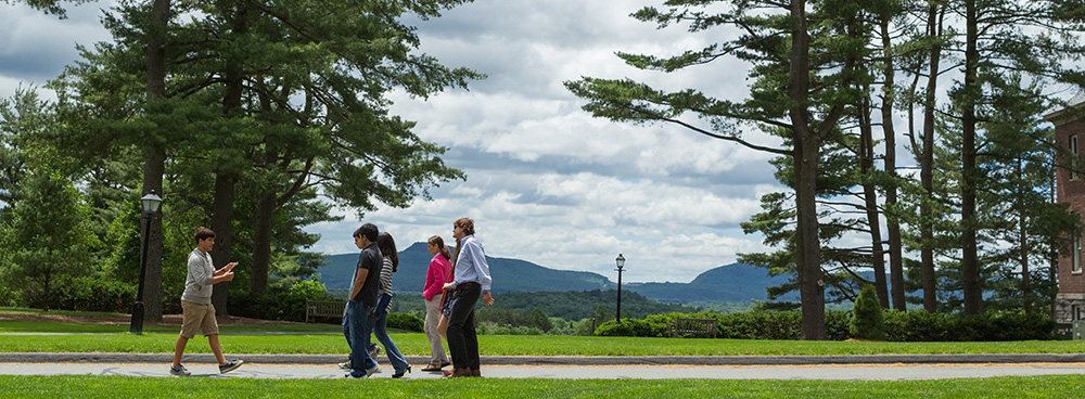 Amherst College student giving a campus tour to visitors