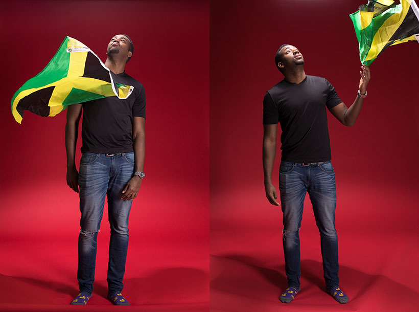 Christopher Lewis holding the Jamacian flag
