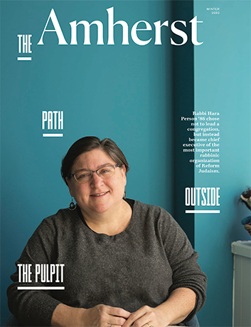 The cover of the winter 2020 issue of Amherst Magazine, with a smiling woman on the cover