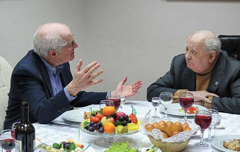 William Taubman and Mikhail Gorbachev sitting together for a meal