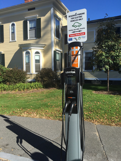 The charger for two cars, with a sign saying Reserved Parking for Electric Vehicles Only