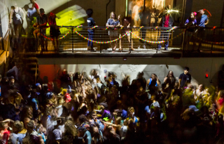 Student crowd in the Powerhouse at night, dancing