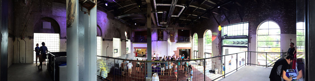 upper and lower levels of the Powerhouse nightclub, with students gathered