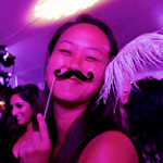 A member of the Class of 2016 sports a costume mustache at Senior Ball