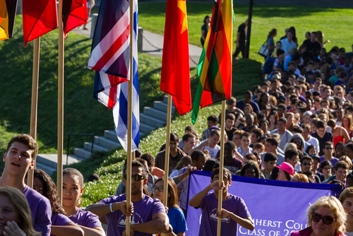 students carrying flags at Orientation