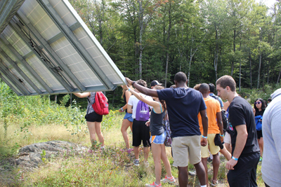 Students touching a solar panel