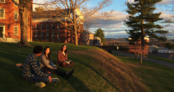 Students sitting on the hill by Johnson Chapel
