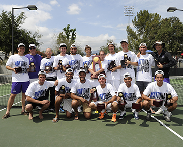 Amherst men's tennis team poses on court with NCAA trophies