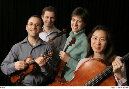 Brentano String Quartet holding their instruments