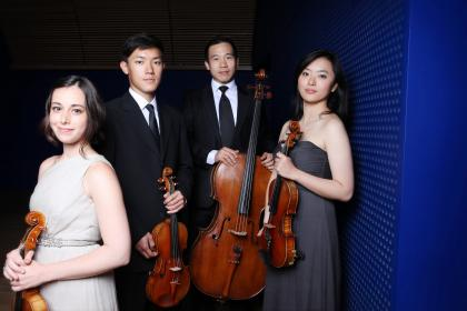 Parker Quartet holding their instruments