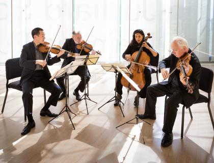 Juilliard Quartet, seating and playing their instruments