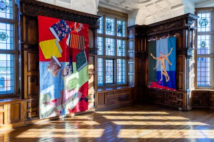 "Installation shot of Rotherwas Project 5: Christopher Myers, The Red Plague Rid You for Learning Me Your Language. Quilts of many different fabrics and colors depicts scenes of Shakespeare's ""The Tempest"" and adorn the wood-paneled rooms of the Rotherwas Room."