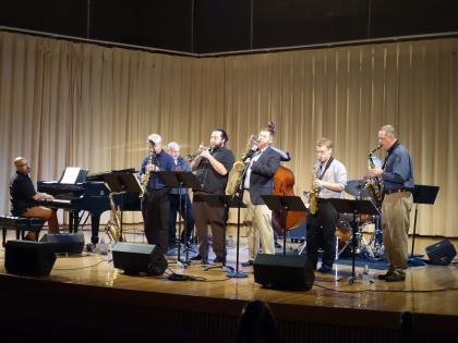 Amherst College jazz faculty playing various instruments on Buckley Recital Hall stage