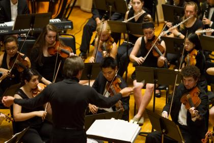 Mark Lane Swanson conducting Amherst Symphony Orchestra musicians