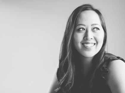 Black-and-white headshot of Arianne Abela