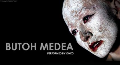 Event poster featuring Yokko's face, in splotchy white makeup, in front of a black background