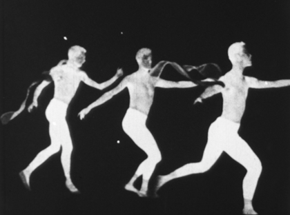 Three white silhouettes of a human figure against a black background, suggesting one person in graceful motion