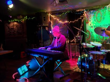 Eric Sawyer playing keyboard amid multicolored lights