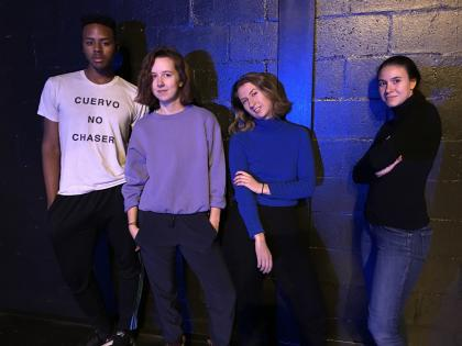 Four Performance Project students standing in a row in front of a brick wall