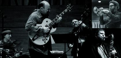 Black-and-white image of the Michael Musillami Trio +2 playing instruments
