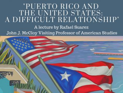 Image Description: picture of event flyer. At the center is an illustration of the ocean and beach with a row of colorful homes to the left, in the foreground is a brown hand holding the United States Flag and the Puerto Rican Flag blowing in the wind. illustration by Gel Jamlang  Image Reads: Puerto Rico and The United States: A Difficult Relationship. A lecture by Rafael Suarez the John J McCloy Visiting Professor of American Studies. Tuesday March, 20 2017 at 6PM to 7PM in the Power House.