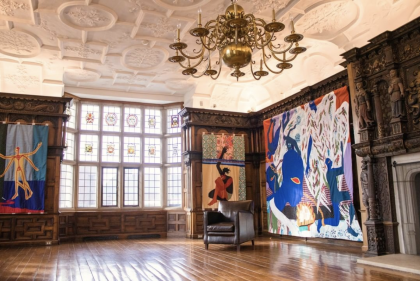 "Installation photo of Rotherwas Project 5: Christopher Myers, The Red Plague Rid You for Learning Me Your Language. Quilts of many different fabrics and colors depicts scenes of Shakespeare's ""The Tempest"" and adorn the wood-paneled rooms of the Rotherwas Room."